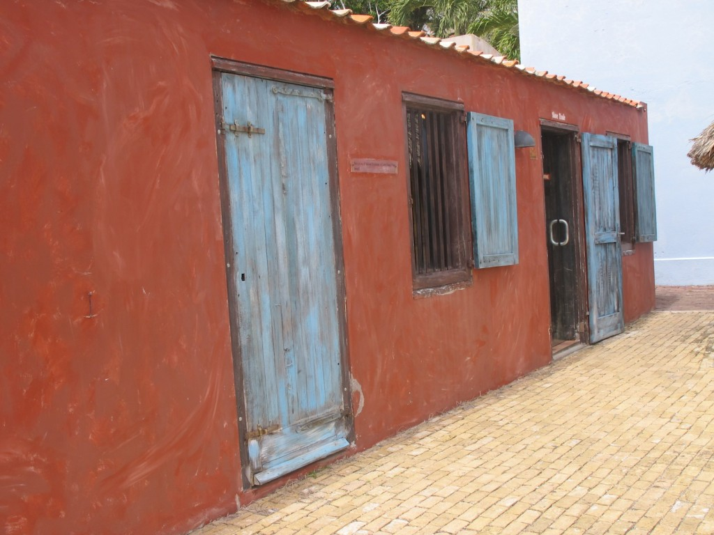 The original slave huts, now part of the museum