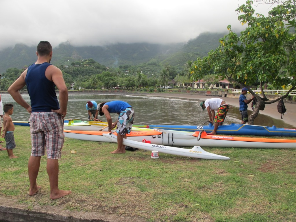 The paddlers rigging their high-tech canoes