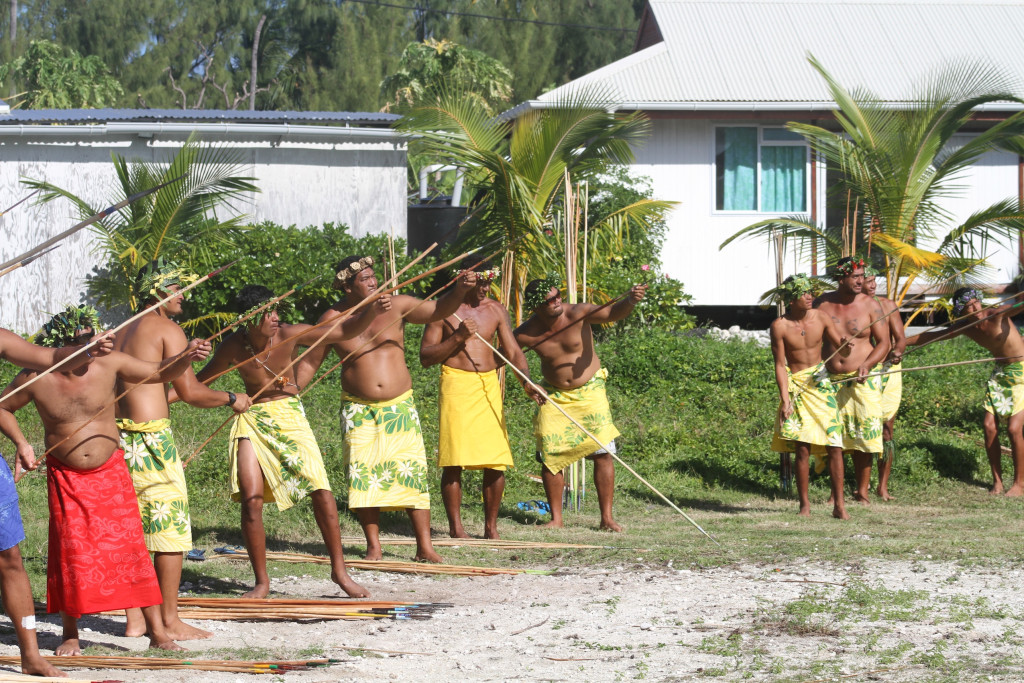 The locals gearing up for the spear-a-coconut-on-a-pole contest
