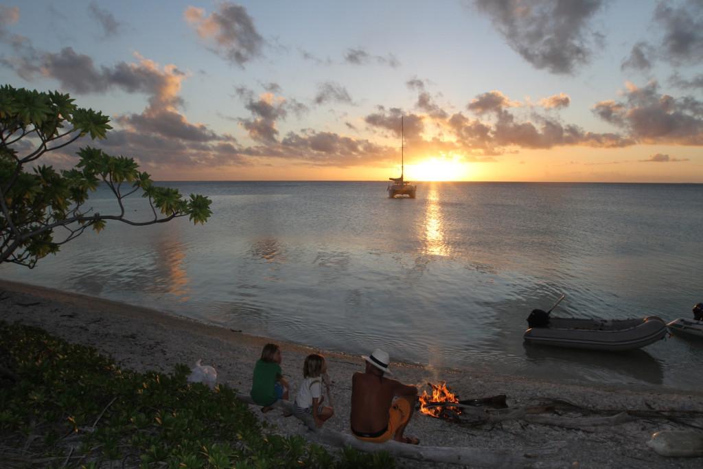 Enjoying the bonfire at sunset