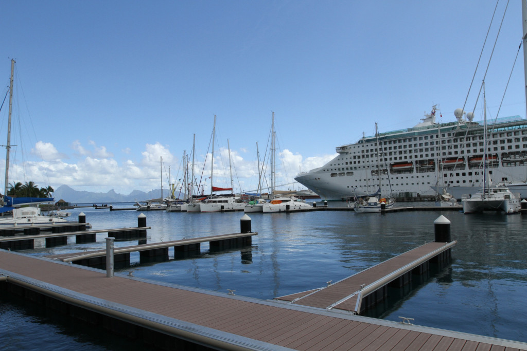 Toucan in the marina, dwarfed by the visiting cruise ship