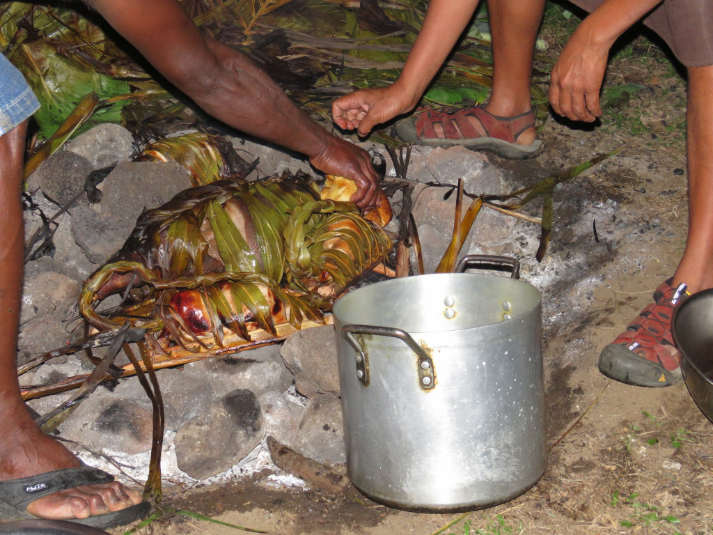Pork and chicken wrapped in banana leaves