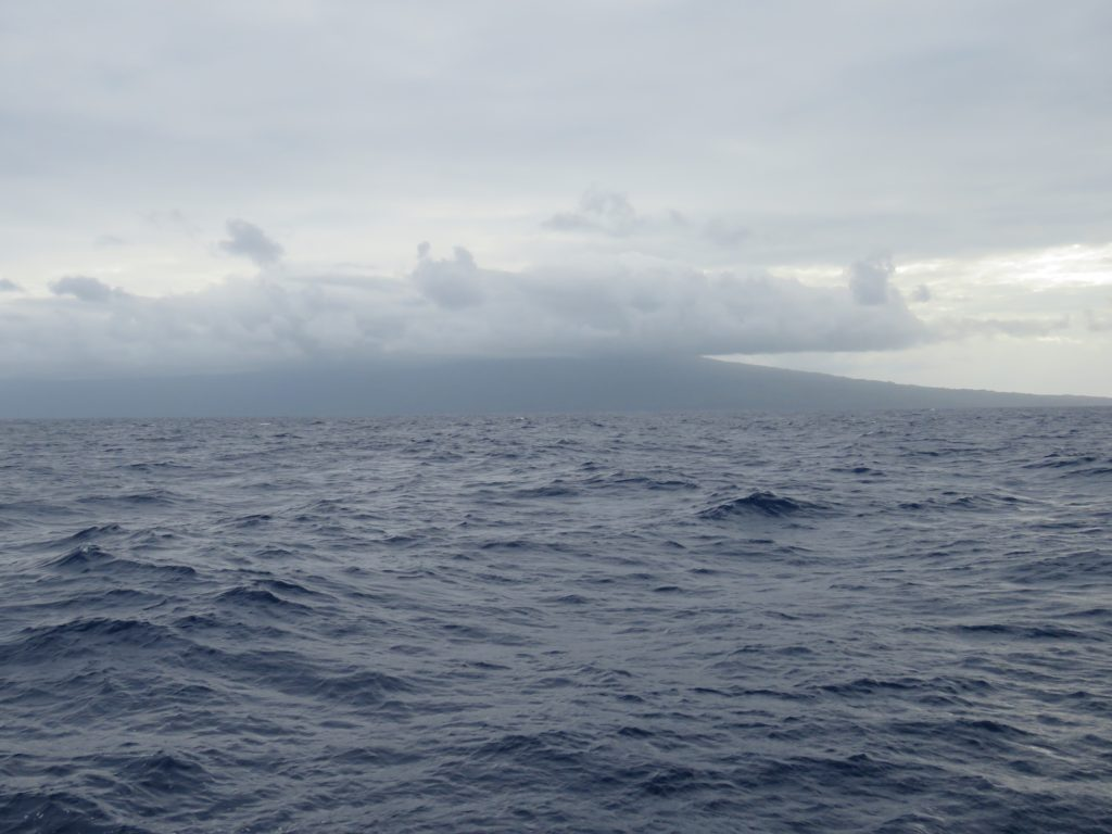 Pentecoste Island wreathed in clouds as we approach Selwyn Strait on the way to Santo